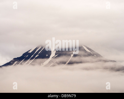 Coastal mountains on the side of Isfjorden on Spitsbergen, Svalbard, Arctic Ocean. - Stock Photo