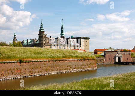 The  renaissance castle Kronborg in Elsinore, Denmark, with the main entrance and the protecting moat in the foreground. - Stock Photo