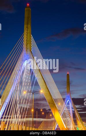 The Leonard P. Zakim Bunker Hill Memorial Bridge (or Zakim Bridge) in Boston, MA at night - Stock Photo