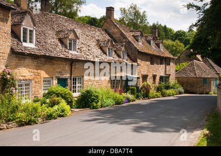 A row of traditionally stone-built cottages in the picturesque Cotswold village of Snowshill in Gloucestershire, - Stock Photo