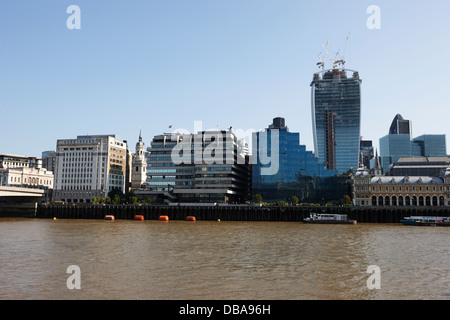 looking across the river thames at the city of London England UK - Stock Photo