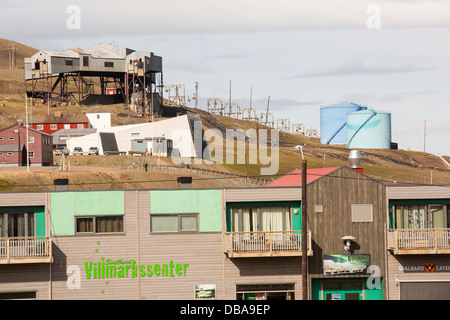 An abandoned coal mine in Longyearbyen on Spitsbergen, Svalbard with shops and houses. - Stock Photo