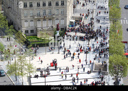 Crowd on Champs Elysées viewed from the top of the Arc de Triomphe, Paris, France - Stock Photo