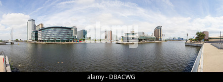 Panoramic shot of Salford Quays, Manchester ship canal including Media City, Lowry Gallery, BBC. - Stock Photo