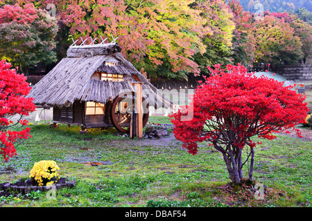 Huts and fall foliage in Kawaguchi, Japan. - Stock Photo