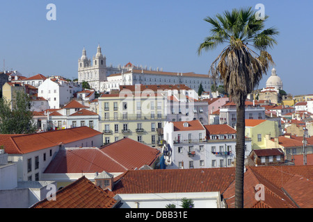 A view of the church of Sao Vicent da Fora from the Largo Portas do Sol in Lisbon, and the dome of Igreja Santa - Stock Photo