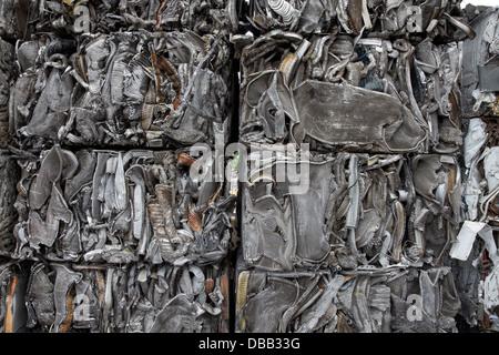 Closeup of scrap metal bales bundled for recycling - Stock Photo