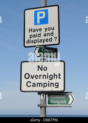 A no overnight camping sign at the seaside, near the beach. - Stock Photo