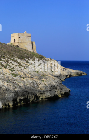 View of Xlendi Tower a small watchtower one of the Lascaris towers dating 1650 near Xlendi Bay on the island of - Stock Photo