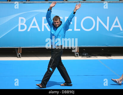 Barcelona, Spain. 27th July, 2013. Sascha Klein of Germany waves ahead of the men's 10m platform diving semifinals - Stock Photo