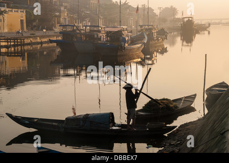 An unidentified fisherman prepares his boat in the harbor on January 10, 2008 in Hoi An, Vietnam - Stock Photo