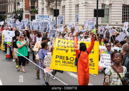London, UK. 27th July, 2013. Protesters march down Whitehall from the US embassy to Downing street demanding Justice - Stock Photo