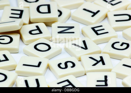 The word LOVE spelled out in square tiles on a white background. - Stock Photo