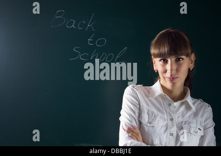 Young attractive Teacher awaiting for student in college - Stock Photo