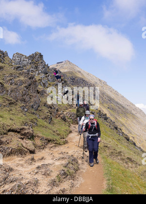 Group of Ramblers descending down the Rhyd Ddu path from Mount Snowdon summit in mountains of Snowdonia National - Stock Photo