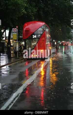London, UK. 27th July, 2013. Traffic in the storm on Tottenham Court Road,London, UK Credit:  martyn wheatley/Alamy - Stock Photo