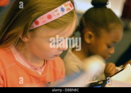 London, UK. 27th July 2013.Children playing Nintendo Unleashed at the Hype Japan 2013 in London. Credit:  See Li/Alamy - Stock Photo