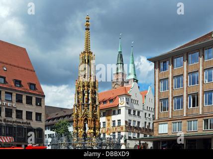 Schoner Brunnen (Beautiful fountain) in the main market, Nuremberg, Bavaria, Germany, Western Europe. - Stock Photo