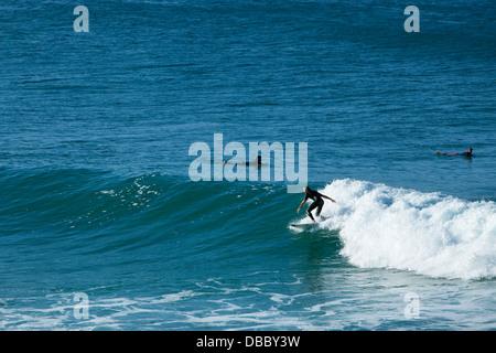Surfer riding a wave. Coolangatta, Gold Coast, Queensland, Australia - Stock Photo