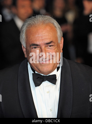 Former IMF chief Dominique Strauss-Kahn walks the red carpet during the 2013 Cannes film festival. - Stock Photo