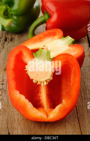Cross section red bell pepper on wooden background - Stock Photo