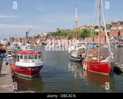Whitby Yorkshire UK looking over Inner Harbour to St. Marys Parish Church - Stock Photo
