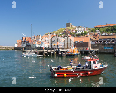 Whitby Harbour Fishing boat and St. Mary's Parish Church Yorkshire UK - Stock Photo