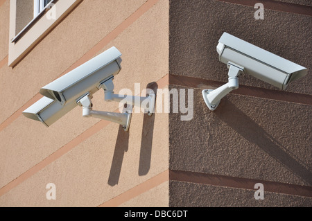 building with security cameras watching around - Stock Photo