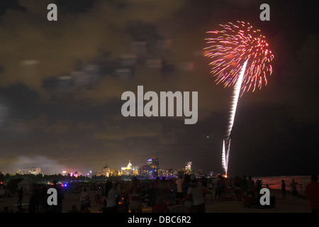Miami Beach Florida Fourth 4th of July fireworks display celebration public event burst night Atlantic Ocean shoreline - Stock Photo