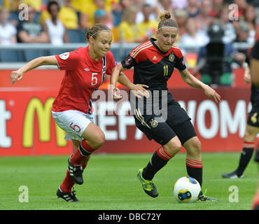 Solna, Sweden. 28th July, 2013. Anja Mittag (R) of Germany fights for the ball with Ingvild Stensland of Norway during the UEFA Women«s EURO 2013 final soccer match between Germany and Norway at the Friends Arena in Solna, Sweden, 28 July 2013. Photo: Carmen Jaspersen/dpa/Alamy Live News