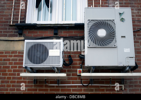 air conditioning units on the exterior of a building - Stock Photo
