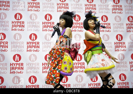 Earls Court, London UK. 27th July, 2013. Yanakiku, who represent Japanese pop culture, perform live on stage at - Stock Photo