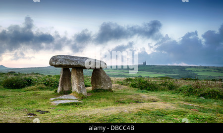 Lanyon Quoit near Madron on the Lands End Peninsula in Cornwall, with a Cornish tin mine in the distance. - Stock Photo