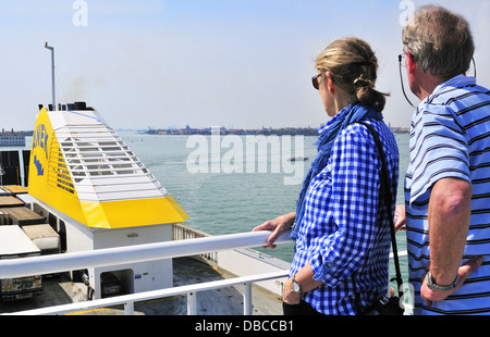 Adult couple of tourists view Venice from the top deck of the Anek car ferry travelling from Venice, Italy to Patras, - Stock Photo