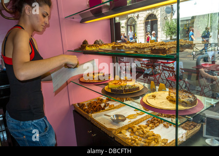 Marseilles, France, Inside French Bakery Patisserie Shop, Cakes on Display, Clerk Serving in South of France - Stock Photo