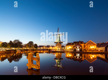Landmark windmill De Adriaan in Haarlem Holland, The Netherlands. On the Spaarne River, canal with restaurant Zuidam - Stock Photo