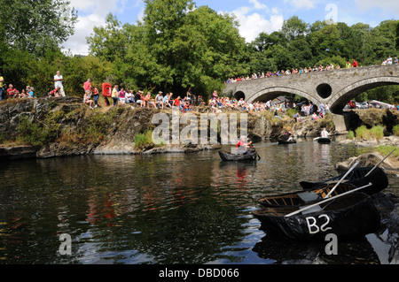 Coracle and coracle cwrwgl demonstration on the Teifi River Cenarth Falls Wales Cymru UK GB - Stock Photo