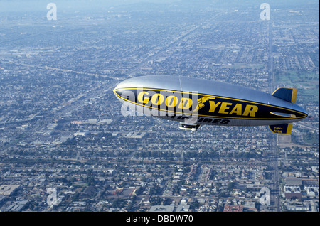 The now-retired Goodyear blimp 'Eagle' cruises above Los Angeles after taking off from the airship's West Coast - Stock Photo
