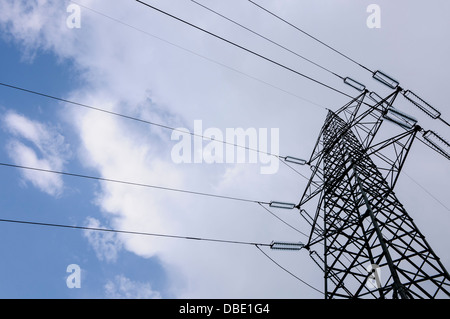 High voltage power tower and cables used for distributing electricity - Stock Photo