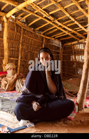 Inside Tuareg tent made from woven mats with village chief, in the home of his married daughter and her husband, - Stock Photo