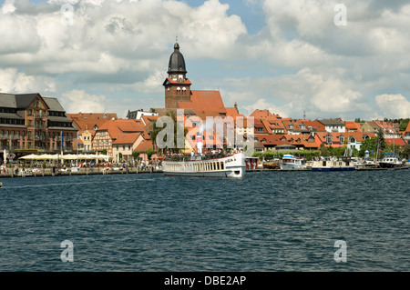 Tourist boat 'Europa' blowing steam whistle whilst leaving Waren Müritz, Germany. - Stock Photo