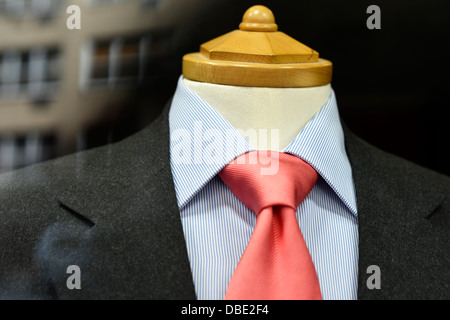 Men's Jacket, Shirt and Tie Displayed on a Store Window Mannequin. - Stock Photo