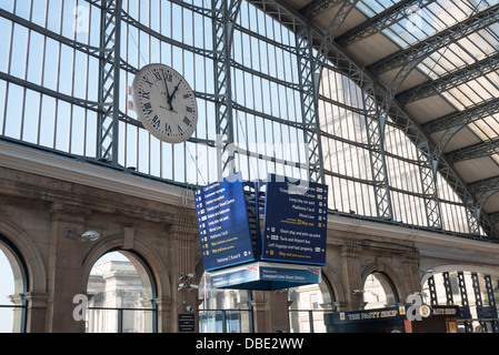 Clock and information sign board at Liverpool Lime Street Railway Station - Stock Photo