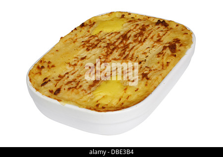 Traditional Homemade Fish Pie in a casserole dish with crispy mashed potatoes on the top - Stock Photo