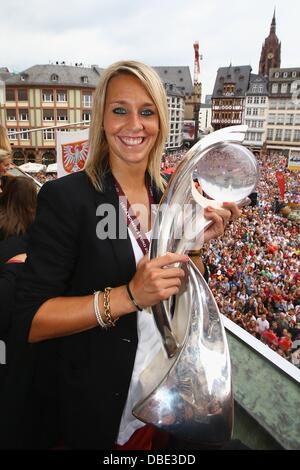 FRANKFURT AM MAIN, GERMANY - JULY 29: Lena Goessling of Germany lifts the trophy of the UEFA Women's EURO 2013 on - Stock Photo