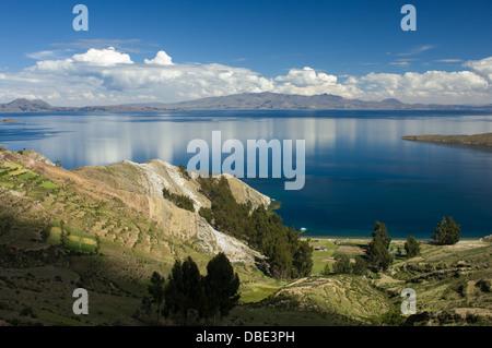 Terraced fields leading down to the shore on the Isla del Sol, Lake Titicaca, near Copacabana, Bolivia - Stock Photo