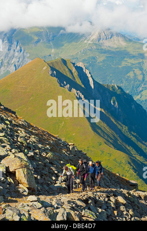 hikers above Chamonix Valley, Mont Blanc, France, Europe - Stock Photo