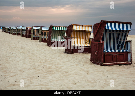 Wickerwork beach seats on the seashore against cloudy sky, Baltic Sea, Poland - Stock Photo