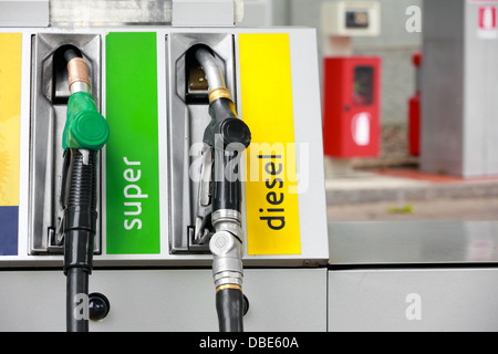Pump nozzles in gas station - Stock Photo