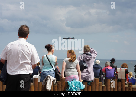 Spectators enjoying the fly past at the 25th Anniversary Sunderland Airshow. - Stock Photo